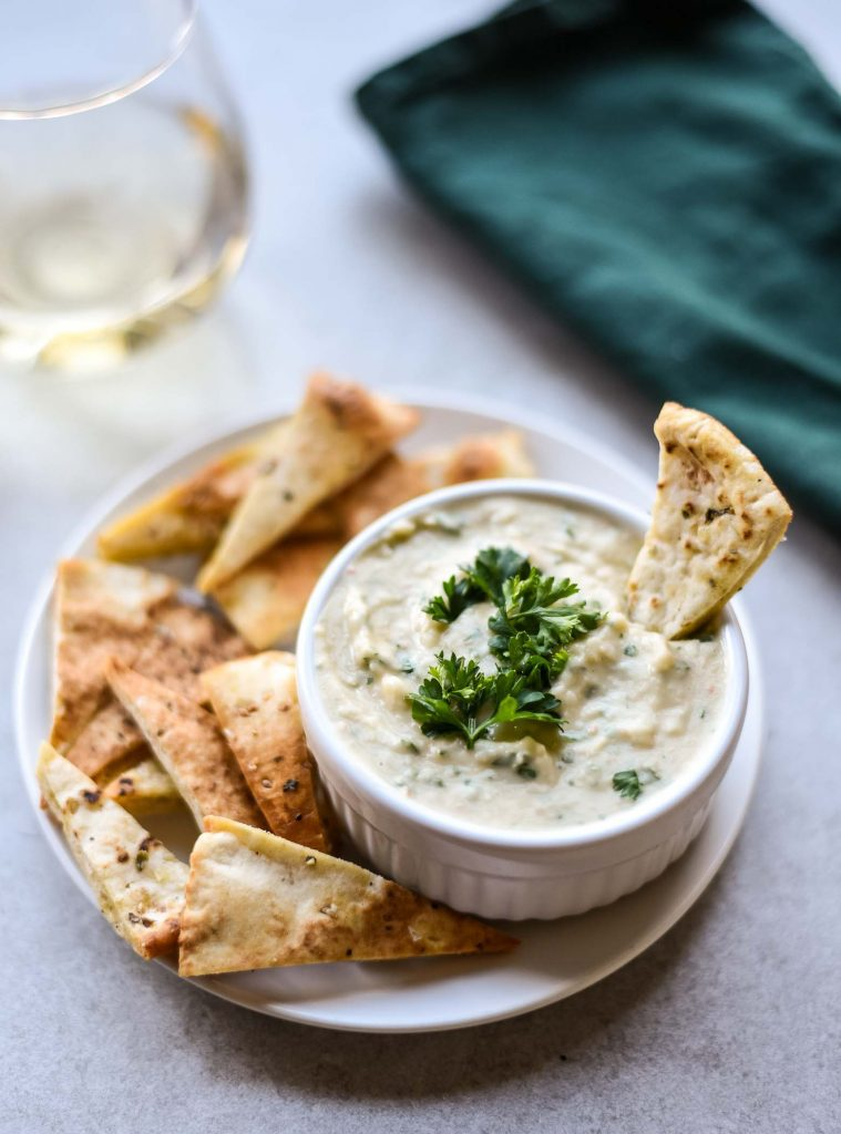 Healthy white bean dip with a glass of white wine