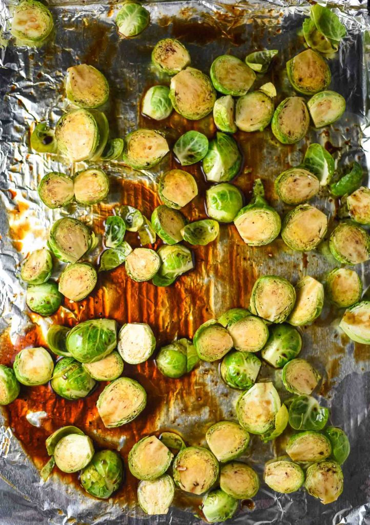 Balsamic roasted brussels sprouts ready to be roasted with balsamic glaze
