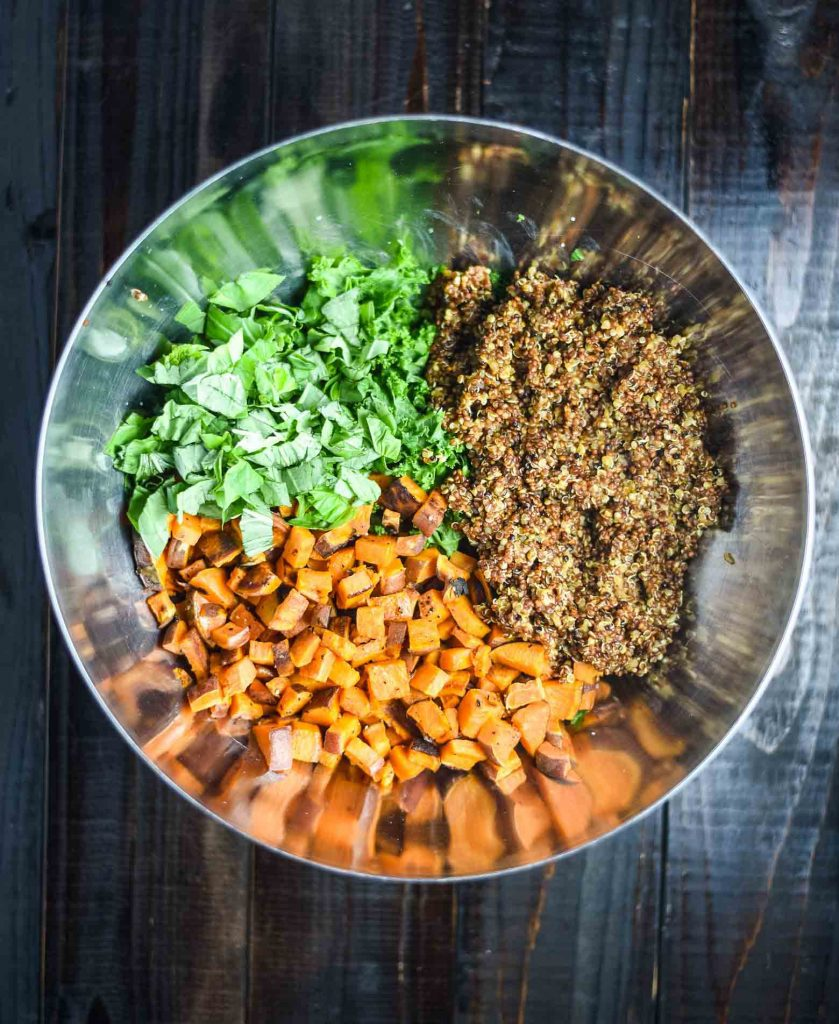 Sweet potato quinoa salad ingredients in a mixing bowl