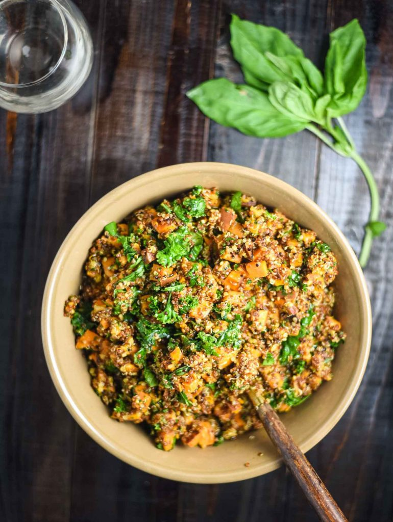 Sweet potato quinoa salad with fresh basil and a glass of wine