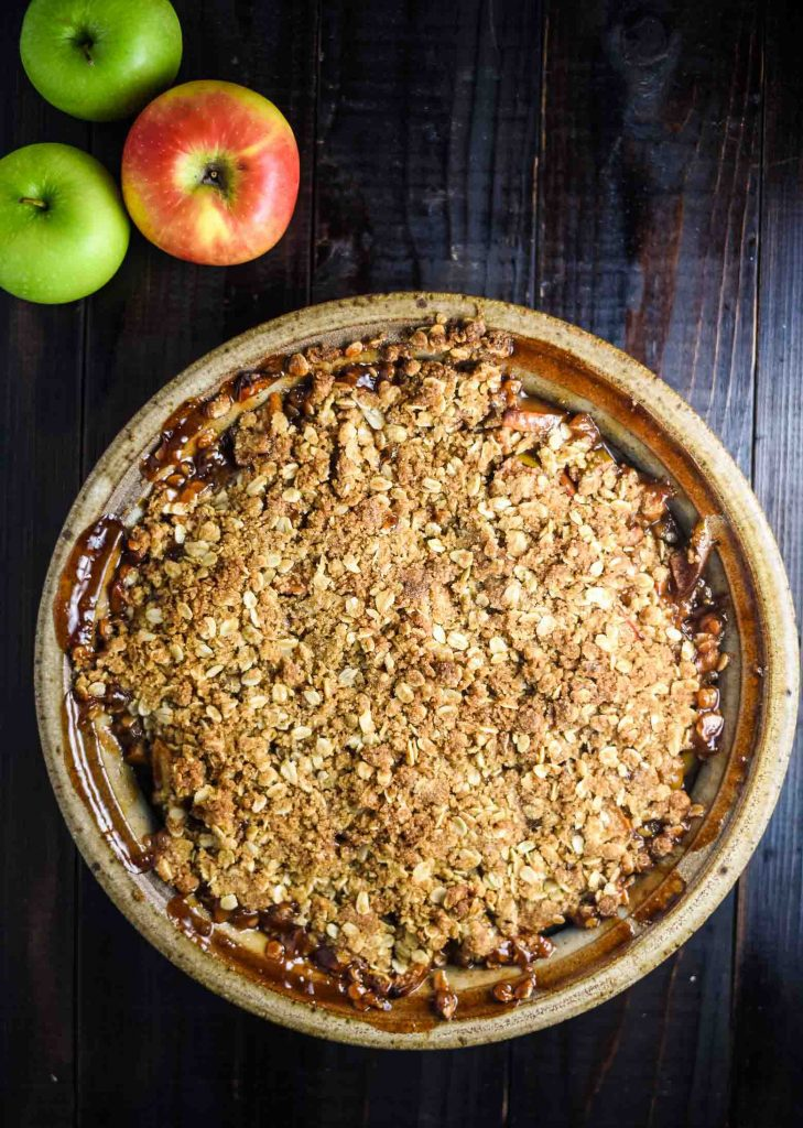 vegan apple crisp with three fresh apples