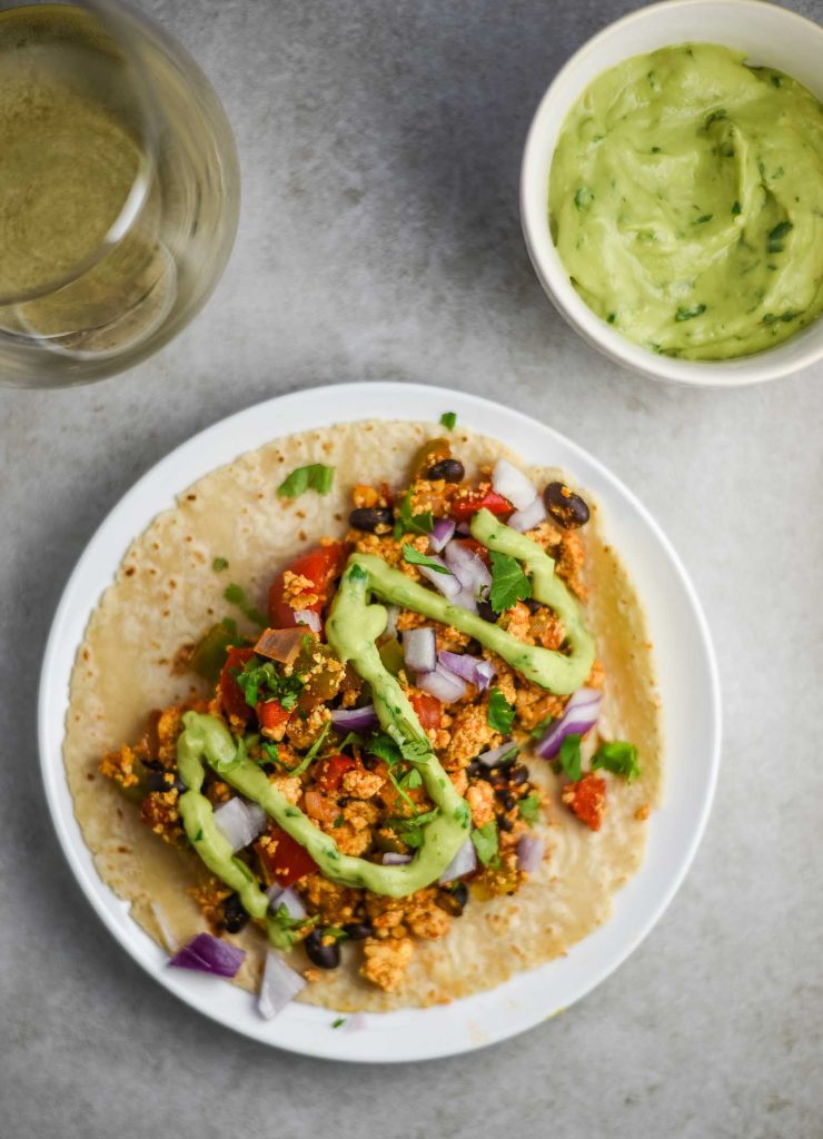 vegan breakfast taco with avocado cilantro sauce