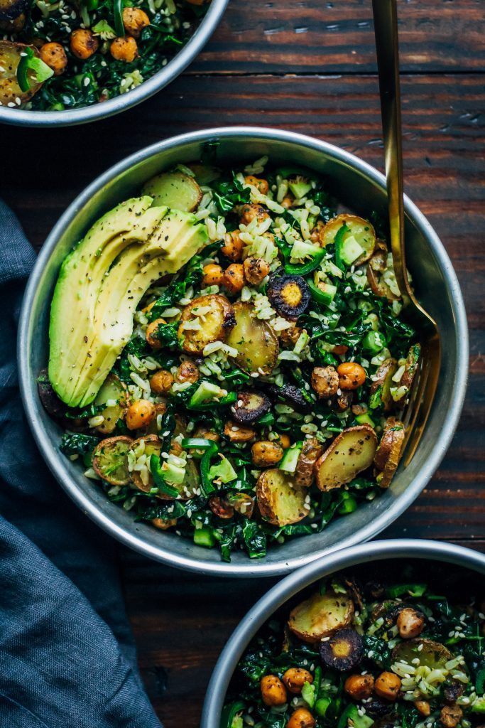 kale detox salad with avocado in a blue bowl