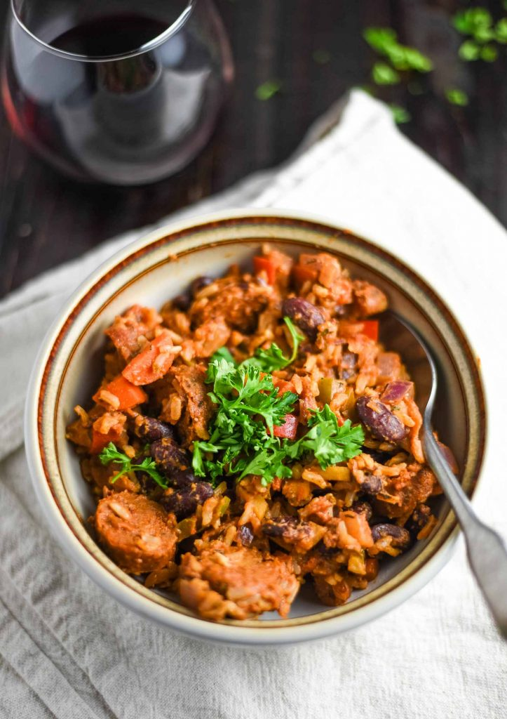 vegan jambalaya in a white bowl with a spoon