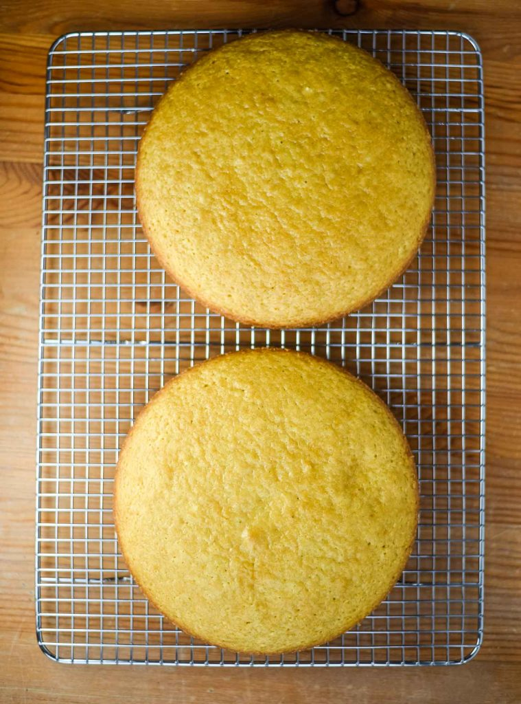 vegan lemon cakes, cooling on a wire rack, fresh out of the oven
